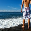 Ready for vocation: a man on the beach — Foto Stock