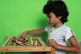 Boy with chess — Stock Photo
