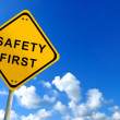 Safety first traffic sign on bluesky — Stock Photo