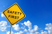 Safety first traffic sign on bluesky — Stockfoto