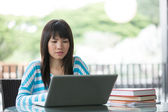 Chinese University student studying at her campus. — Stock Photo