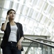 Asian Business woman using a Cell Phone — Stock Photo