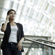Asian Business woman using a Cell Phone — Stock Photo #12001234