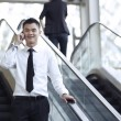 Asian Business man using a Cell Phone — Stock Photo