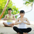 Stock Photo: Man and Woman performing yoga.