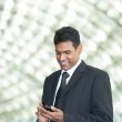 Indian business man using mobile phone. — Stock Photo #12001951