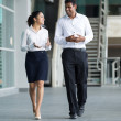 Indian Businessman & woman walking. — Stock Photo