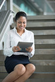 Indian Businesswoman reading her digital tablet. — Stock Photo