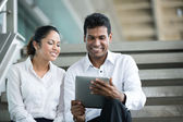 Indian Business looking at a digital tablet. — Stock Photo