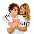 Attractive young couple hugging each other — Stock Photo
