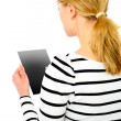 Rear view of teenage girl using touch screen device — Stock Photo