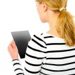 Stock Photo: Rear view of teenage girl using touch screen device