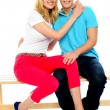 Young couple hugging on bench — Stock Photo