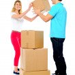 Couple carrying empty cartons — Stock Photo
