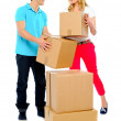 Couple carrying cardboard boxes — Stock Photo
