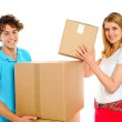 Attractive caucasian couple holding cardboard boxes — Stock Photo