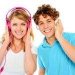 Couple enjoying music through headphones — Stock Photo