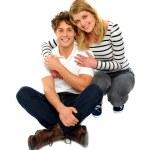 Loving couple sitting and smiling — Stock Photo