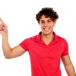Handsome young teenager in casuals pointing away — Stock Photo #10776029