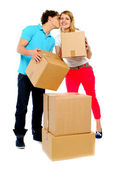 Young couple gently holding cartons — Stock Photo
