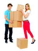 Lovely couple holding cardboard boxes — Stock Photo