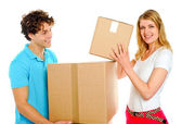 Couple arranging cardboard boxes — Stock Photo