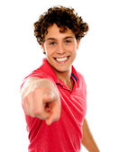 Handsome curly hair teen pointing at you — Stock Photo