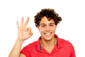 Curly hair guy gesturing excellence sign — Stock Photo