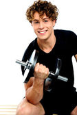 Fit trainer doing biceps exercise — Stock Photo