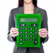 Business woman holding calculator. Focus on calculator — Stock Photo #11011263