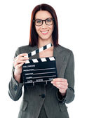 Business lady holding clapperboard — Stock Photo