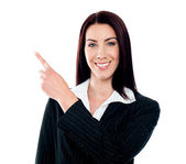 Business lady pointing at copyspace — Stock Photo
