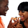 Beautiful african couple eating pizza — Stock Photo