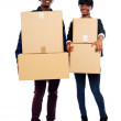 Attractive african couple holding cardboard boxes — Stock Photo
