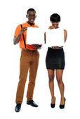 Attractive african couple with pizza boxes — Stock Photo