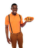 Handsome black man holding pizza — Stock Photo