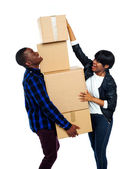Teenage couple with cardboard boxes — Stock Photo