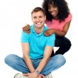 Foto Stock: Love couple sitting on floor