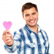 Man showing pink paper heart — Stock Photo