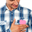 Handsome man holding paper heart — Stock Photo #11131948