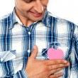 Handsome man holding paper heart — Stock Photo