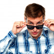 Confident young man peeping from goggles — Stock Photo #11132002