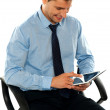Businessman watching videos on tablet pc — Stock Photo #11132133