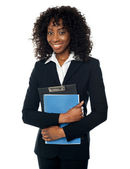 Smiling confident female executive — Stock Photo