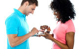 Couple using wireless touch pad device — Stock Photo