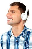 Young man tuned into music — Stock Photo