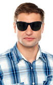 Handsome casual man wearing goggles — Stock Photo
