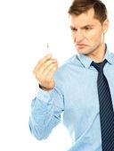 Angry smoker staring at cigarette — Stock Photo