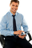 Relaxed businessman using tablet pc — Stock Photo