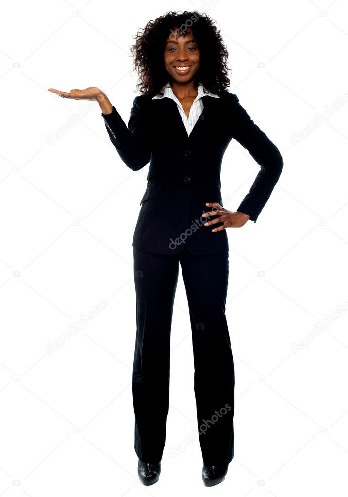 Full length pose of young female ceo presenting copyspace in business — Stock Photo #11131672